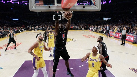 <p>               Los Angeles Clippers' Montrezl Harrell (5) dunks between Los Angeles Lakers' JaVale McGee (7) and Rajon Rondo (9) during the first half of an NBA basketball game, Monday, March 4, 2019, in Los Angeles. (AP Photo/Marcio Jose Sanchez)             </p>