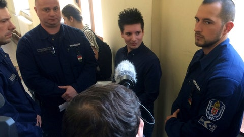 <p>               Portuguese Rui Pinto, center, is surrounded by police officers in the hallway of the Metropolitan Court in Budapest, Hungary, Tuesday, March 5, 2019 as he awaits a decision on his extradition to Portugal. (AP Photo/Pablo Gorondi)             </p>