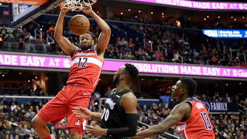 <p>               Washington Wizards forward Jabari Parker (12) dunks over Minnesota Timberwolves guard Josh Okogie (20) during the second half of an NBA basketball game, Sunday, March 3, 2019, in Washington. Also seen is Wizards center Thomas Bryant (13). The Wizards won 135-121. (AP Photo/Nick Wass)             </p>