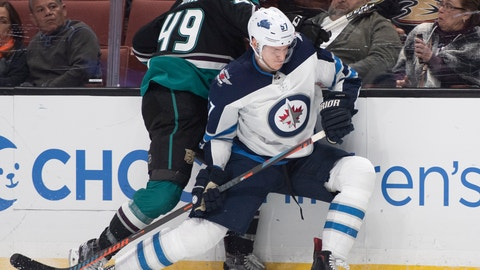 <p>               Winnipeg Jets defenseman Tyler Myers, right, and Anaheim Ducks left wing Max Jones compete for the puck during the second period of an NHL hockey game in Anaheim, Calif., Wednesday, March 20, 2019. (AP Photo/Kyusung Gong)             </p>
