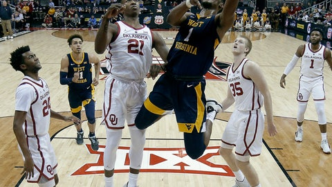 <p>               West Virginia's Derek Culver (1) gets past Oklahoma's Kristian Doolittle (21) to put up a shot during the first half of an NCAA college basketball game in the Big 12 men's tournament Wednesday, March 13, 2019, in Kansas City, Mo. (AP Photo/Charlie Riedel)             </p>