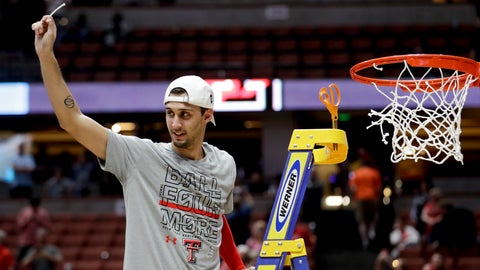 <p>               Texas Tech guard Davide Moretti holds up a piece of the net after the team's win over Gonzaga in the West Regional final in the NCAA men's college basketball tournament Saturday, March 30, 2019, in Anaheim, Calif. Texas Tech won 75-69. (AP Photo/Marcio Jose Sanchez)             </p>