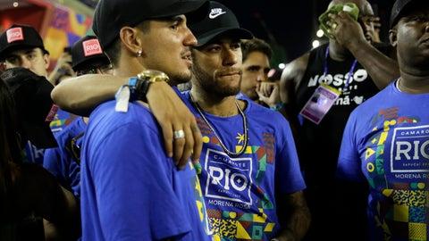 <p>               Brazil's soccer player Neymar, center, and surfer Gabriel Medina attend the Carnival celebrations at the Sambadrome in Rio de Janeiro, Brazil, Tuesday, March 5, 2019. (AP Photo/Silvia Izquierdo)             </p>