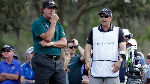 <p>               Phil Mickelson, left, listens to his brother and caddie Tim Mickelson as he waits to tee off on the ninth hole during the second round of The Players Championship golf tournament Friday, March 15, 2019, in Ponte Vedra Beach, Fla. (AP Photo/Lynne Sladky)             </p>