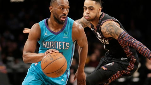 <p>               Charlotte Hornets' Kemba Walker, left, drives past Brooklyn Nets' D'Angelo Russell during the first half of an NBA basketball game Friday, March 1, 2019, in New York. (AP Photo/Seth Wenig)             </p>