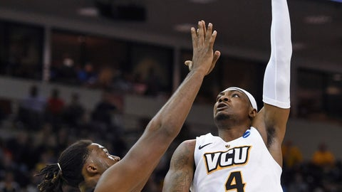<p>               VCU's Corey Douglas (4) shoots over Central Florida's Chad Brown during a first-round game in the NCAA men's college basketball tournament Friday, March 22, 2019, in Columbia, S.C.. (AP Photo/Richard Shiro)             </p>