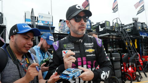 <p>               Jimmie Johnson looks up while signing autographs before practice for the NASCAR Cup Series auto race at Texas Motor Speedway in Fort Worth, Texas, Friday, March 29, 2019. (AP Photo/LM Otero)             </p>