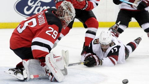 <p>               New Jersey Devils goaltender MacKenzie Blackwood (29) protects the net as Arizona Coyotes center Alex Galchenyuk (17) falls to the ice while attacking during the first period of an NHL hockey game, Saturday, March 23, 2019, in Newark, N.J. (AP Photo/Julio Cortez)             </p>