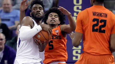 <p>               Washington guard Jaylen Nowell, left, grabs a rebound away from Oregon State guard Ethan Thompson (5) during the second half of an NCAA college basketball game Wednesday, March 6, 2019, in Seattle. Washington won 81-76 in overtime. (AP Photo/Ted S. Warren)             </p>