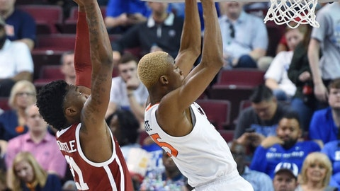 <p>               Virginia's Mamadi Diakite (25) pulls in a rebound while defended by Oklahoma's Kristian Doolittle (21) during the second half of a second-round men's college basketball game in the NCAA Tournament in Columbia, S.C. Sunday, March 24, 2019. (AP Photo/Richard Shiro)             </p>