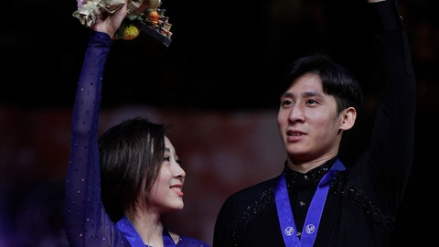 <p>               China's Sui Wenjing and Han Cong acknowledge the crowd after winning gold for the pairs free skate during the ISU World Figure Skating Championships at Saitama Super Arena in Saitama, north of Tokyo, Thursday, March 21, 2019. (AP Photo/Andy Wong)             </p>