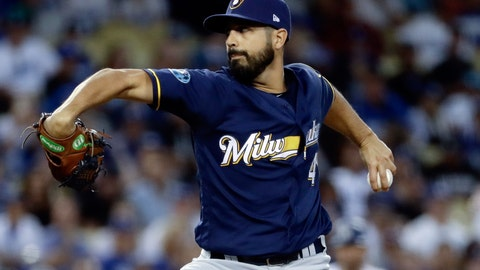 <p>               FILE - In this Oct. 16, 2018, file photo, Milwaukee Brewers starting pitcher Gio Gonzalez throws during the first inning of Game 4 of the National League Championship Series baseball game against the Los Angeles Dodgers in Los Angeles. A person familiar with the negotiations tells The Associated Press that left-hander Gonzalez and the New York Yankees have agreed to a minor league contract. The person spoke on condition of anonymity Monday, March 18, 2019, because the agreement had not yet been announced. (AP Photo/Matt Slocum, File)             </p>