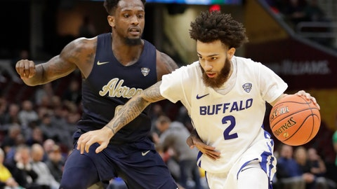 <p>               Buffalo's Jeremy Harris (2) drives past Akron's Jimond Ivey (0) during the first half of an NCAA college basketball game at the Mid-American Conference tournament, Thursday, March 14, 2019, in Cleveland. (AP Photo/Tony Dejak)             </p>
