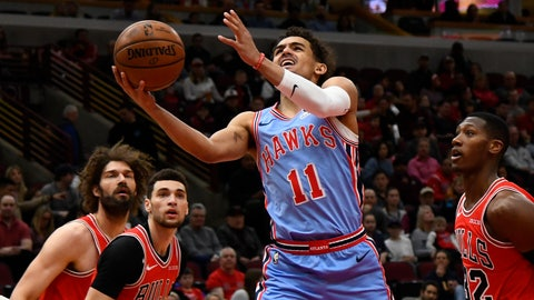 <p>               Atlanta Hawks guard Trae Young (11) shoots against Chicago Bulls guard Kris Dunn (32) during the first half of an NBA basketball game Sunday, March. 3, 2019, in Chicago. (AP Photo/Matt Marton)             </p>