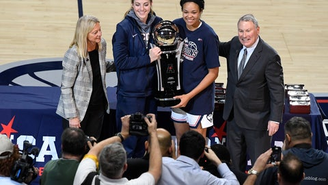 <p>               Connecticut's Katie Lou Samuelson, second from top left, and Napheesa Collier, second from top right, hold the American Athletic Conference (AAC) women's tournament championship trophy presented by associate commissioner for women's basketball Barbara Jacobs, top left, and AAC commissioner Mike Aresco, right, after defeating UCF in an NCAA college basketball game in the AAC women's tournament finals, Monday, March 11, 2019, at Mohegan Sun Arena in Uncasville, Conn. (AP Photo/Jessica Hill)             </p>