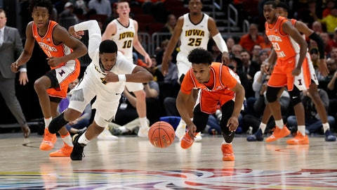 <p>               Iowa's Isaiah Moss (4) and Illinois's Trent Frazier chase the loose ball during the first half of an NCAA college basketball game in the second round of the Big Ten Conference tournament, Thursday, March 14, 2019, in Chicago. (AP Photo/Nam Y. Huh)             </p>