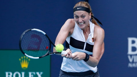 <p>               Petra Kvitova, of the Czech Republic, returns a volley to Caroline Garcia, of France, during the Miami Open tennis tournament, Monday, March 25, 2019, in Miami Gardens, Fla. (AP Photo/Joel Auerbach)             </p>