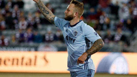 <p>               Sporting Kansas City forward Johnny Russell celebrates after scoring the tying goal against the Colorado Rapids during the second half of an MLS soccer match Sunday, March 17, 2019, in Commerce City, Colo. The teams tied 1-1. (AP Photo/David Zalubowski)             </p>