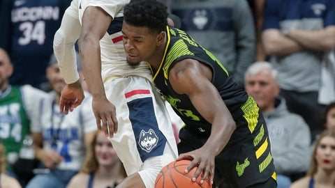 <p>               Connecticut's Alterique Gilbert, left, tries to block South Florida's Justin Brown, right, during the second half of an NCAA college basketball game, Sunday, March 3, 2019, in Storrs, Conn. (AP Photo/Steven Senne)             </p>