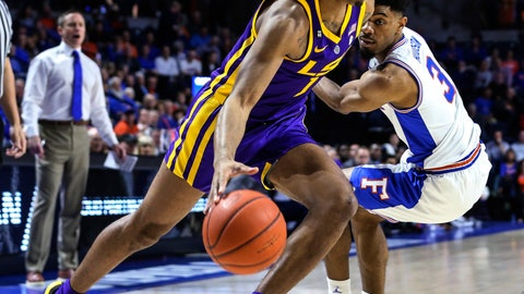 <p>               LSU guard Javonte Smart (1) drives to the basket while defended by Florida guard Jalen Hudson (3) during the first half of an NCAA college basketball game in Gainesville, Fla., Wednesday, March 6, 2019. (AP Photo/Gary McCullough)             </p>