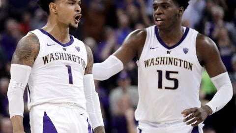 <p>               Washington guard David Crisp (1) celebrates with forward Noah Dickerson (15) during overtime in an NCAA college basketball game against Oregon State, Wednesday, March 6, 2019, in Seattle. Washington won 81-76. (AP Photo/Ted S. Warren)             </p>