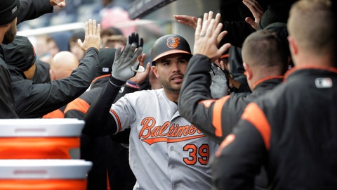 <p>               Baltimore Orioles' Renato Nunez (39) is greeted by teammates after hitting a three-run home run during the first inning of a baseball game against the New York Yankees at Yankee Stadium, Sunday, March 31, 2019, in New York. (AP Photo/Seth Wenig)             </p>