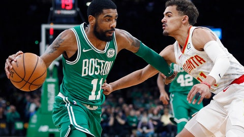 <p>               Boston Celtics' Kyrie Irving, left, drives past Atlanta Hawks' Trae Young during the first half of an NBA basketball game in Boston, Saturday, March 16, 2019. (AP Photo/Michael Dwyer)             </p>
