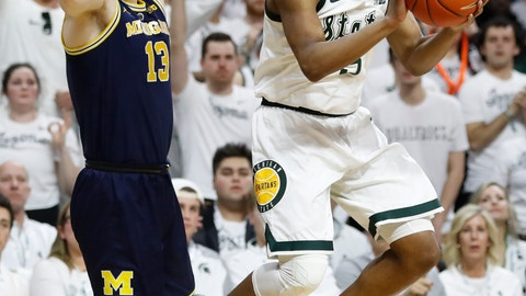 <p>               Michigan State guard Cassius Winston (5) passes the ball as Michigan forward Ignas Brazdeikis (13) defends during the first half of an NCAA college basketball game Saturday, March 9, 2019, in East Lansing, Mich. (AP Photo/Carlos Osorio)             </p>