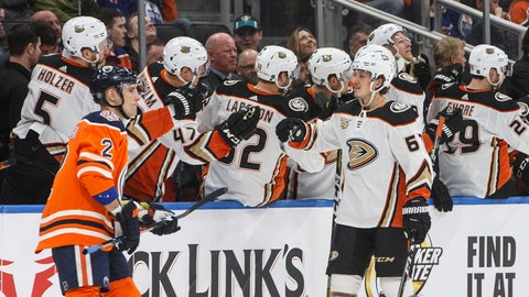 <p>               Anaheim Ducks' Rickard Rakell (67) celebrates a goal as Edmonton Oilers' Andrej Sekera (2) skates past during the second period of an NHL hockey game Saturday, March 30, 2019, in Edmonton, Alberta. (Jason Franson/The Canadian Press via AP)             </p>