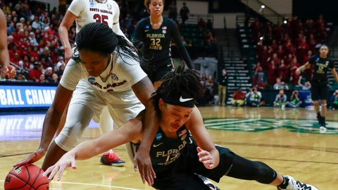 <p>               South Carolina guard Doniyah Cliney, left, and Florida State guard Nausla Woolfolk, right, battle for the ball during the first half of a second-round women's college basketball game in the NCAA Tournament in Charlotte, N.C., Sunday, March 24, 2019. (AP Photo/Jason E. Miczek)             </p>
