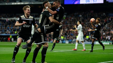 <p>               Ajax's Hakim Ziyech, right, celebrates scoring the opening goal during the Champions League soccer match between Real Madrid and Ajax at the Santiago Bernabeu stadium in Madrid, Spain, Tuesday, March 5, 2019. (AP Photo/Manu Fernandez)             </p>