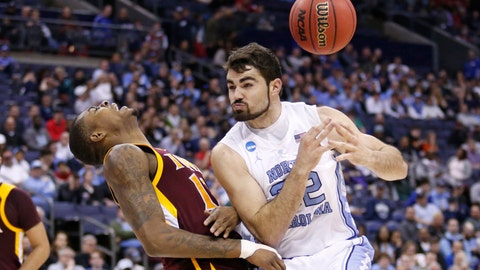 <p>               North Carolina's Luke Maye, right, loses control of the ball after colliding with Iona's Tajuan Agee during the second half of a first-round game in the NCAA men's college basketball tournament in Columbus, Ohio, Friday, March 22, 2019. North Carolina won 88-73. (AP Photo/Paul Vernon)             </p>