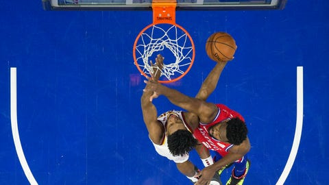 <p>               Cleveland Cavaliers' Collin Sexton, left, shoots against Philadelphia 76ers' Joel Embiid, right, of Cameroon, during the first half of an NBA basketball game, Tuesday, March 12, 2019, in Philadelphia. (AP Photo/Chris Szagola)             </p>