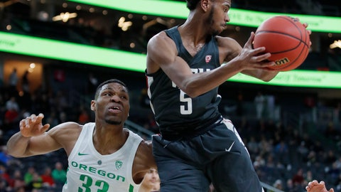 <p>               Washington State's Marvin Cannon grabs a rebound over Oregon's Francis Okoro during the first half of an NCAA college basketball game in the first round of the Pac-12 men's tournament Wednesday, March 13, 2019, in Las Vegas. (AP Photo/John Locher)             </p>