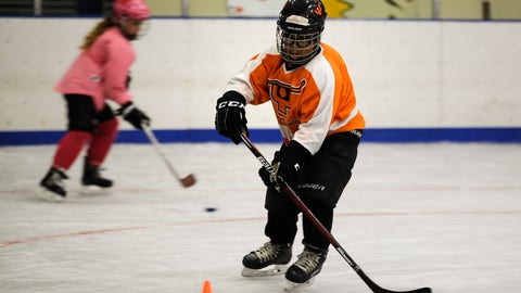 <p>               In this Feb. 21, 2019 photo Logan Johnson takes part in a Snider Hockey practice at the Scanlon Ice Rink in Philadelphia. (AP Photo/Matt Rourke)             </p>