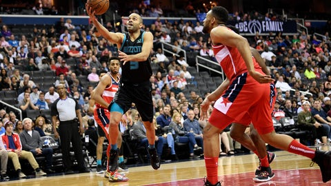 <p>               Charlotte Hornets guard Tony Parker (9) goes to the basket against Washington Wizards forward Jabari Parker, right, during the first half of an NBA basketball game, Friday, March 15, 2019, in Washington. (AP Photo/Nick Wass)             </p>