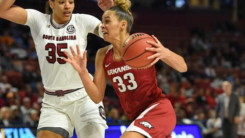 <p>               Arkansas' Chelsea Dungee, right, drives while defended by South Carolina's Alexis Jennings during the first half of an NCAA college basketball game in the Southeastern Conference women's tournament Friday, March 8, 2019, in Greenville, S.C. (AP Photo/Richard Shiro)             </p>