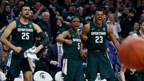 <p>               From left, Michigan State forward Kenny Goins (25), guard Cassius Winston (5), and forward Xavier Tillman (23) react after a basket by Brock Washington during the second half of an NCAA college basketball game against Nebraska, Tuesday, March 5, 2019, in East Lansing, Mich. (AP Photo/Carlos Osorio)             </p>
