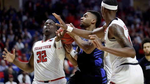 <p>               Buffalo's Jayvon Graves, center, heads to the basket as Texas Tech's Norense Odiase (32) and Tariq Owens defend during the second half of a second round men's college basketball game in the NCAA Tournament Sunday, March 24, 2019, in Tulsa, Okla. Texas Tech won 78-58. (AP Photo/Jeff Roberson)             </p>