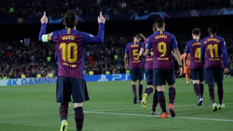 <p>               Barcelona's Lionel Messi, left, celebrates after scoring his side's third goal during the Champions League round of 16, 2nd leg, soccer match between FC Barcelona and Olympique Lyon at the Camp Nou stadium in Barcelona, Spain, Wednesday, March 13, 2019. (AP Photo/Emilio Morenatti)             </p>