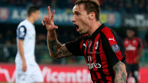 <p>               Milan's Lucas Biglia celebrates after scoring during the Italian Serie A soccer match between AC Chievo Verona and AC Milan at the Marcantonio Bentegodi stadium in Verona, Italy, Saturday March 9, 2019. (Filippo Venezia/ANSA via AP)             </p>