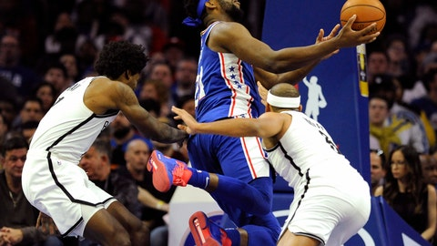 <p>               Philadelphia 76ers' Joel Embiid, center, drives to the basket as Brooklyn Nets' Jared Dudley, right, and Ed Davis, left, defend during the second half of an NBA basketball game, Thursday, March 28, 2019, in Philadelphia. (AP Photo/Michael Perez)             </p>