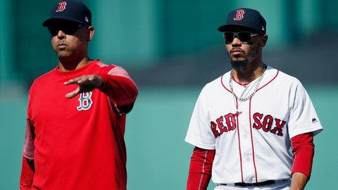 <p>               FILE - In this Sept. 16, 2018, file photo, Boston Red Sox manager Alex Cora, left, escorts Mookie Betts off the field during the sixth inning of the team's baseball game against the New York Mets in Boston. Betts drove in just 80 runs last year while spending almost all of his time as the Red Sox leadoff hitter. That seemed like a missed opportunity, so Cora is planning to bat Betts second this season and move Andrew Benintendi to leadoff. (AP Photo/Michael Dwyer, File)             </p>