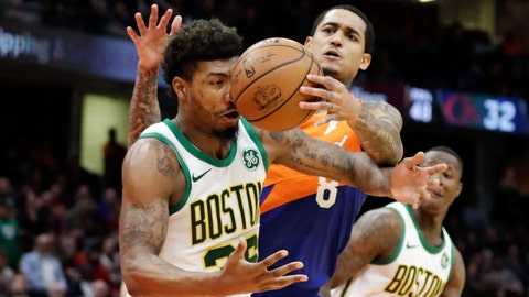 <p>               Boston Celtics' Marcus Smart, left, and Cleveland Cavaliers' Jordan Clarkson battle for a loose ball in the second half of an NBA basketball game, Tuesday, March 26, 2019, in Cleveland. Boston won 116-106. (AP Photo/Tony Dejak)             </p>