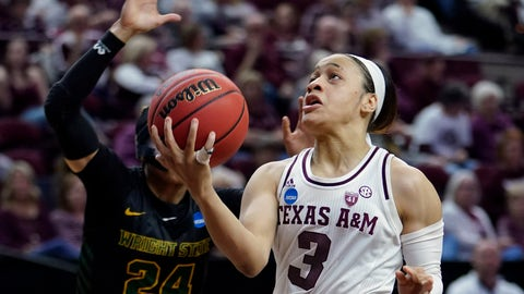 <p>               Texas A&M's Chennedy Carter (3) goes up or a shot as Wright State's Michal Miller (24) defends during the first half of a first round women's college basketball game in the NCAA Tournament Friday, March 22, 2019, in College Station, Texas. (AP Photo/David J. Phillip)             </p>