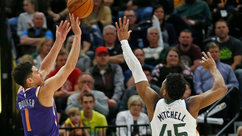 <p>               Phoenix Suns guard Devin Booker (1) shoots as Utah Jazz guard Donovan Mitchell (45) defends during the second half of an NBA basketball game Monday, March 25, 2019, in Salt Lake City. (AP Photo/Rick Bowmer)             </p>