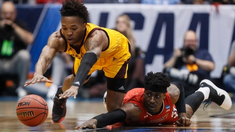 <p>               Arizona State's Kimani Lawrence, left, and St. John's Sedee Keita, right, dive for a loose ball during the first half of a First Four game of the NCAA men's college basketball tournament, Wednesday, March 20, 2019, in Dayton, Ohio. (AP Photo/John Minchillo)             </p>