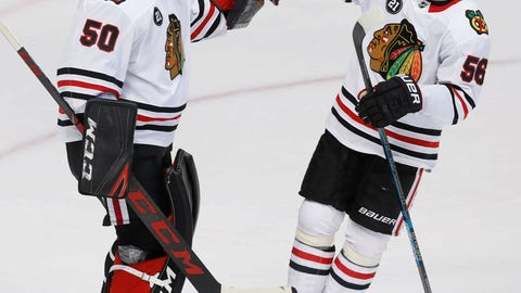 <p>               Chicago Blackhawks goaltender Corey Crawford (50) is congratulated by Erik Gustafsson (56) after the team's NHL hockey game against the Dallas Stars in Dallas, Saturday, March 9, 2019. The Blackhawks won 2-1. (AP Photo/LM Otero)             </p>