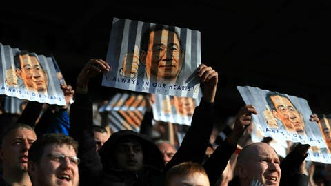 <p>               Leicester City fans in the stands hold up banners in honour of late chairman Vichai Srivaddhanaprabha during the English Premier League soccer match between Leicester City and Bournemouth at the King Power Stadium, in Leicester, England, Saturday March 30, 2019. (Mike Egerton/PA via AP)             </p>