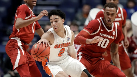 <p>               Florida guard Andrew Nembhard (2) moves away from Arkansas forward Daniel Gafford (10) in the first half of an NCAA college basketball game at the Southeastern Conference tournament Thursday, March 14, 2019, in Nashville, Tenn. (AP Photo/Mark Humphrey)             </p>